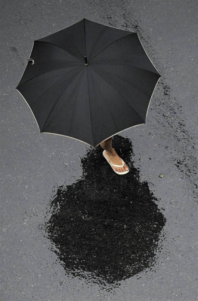 A woman crosses a street under heavy rain in Buenos Aires, Argentina, on Feb. 5.  Juan Mabromata