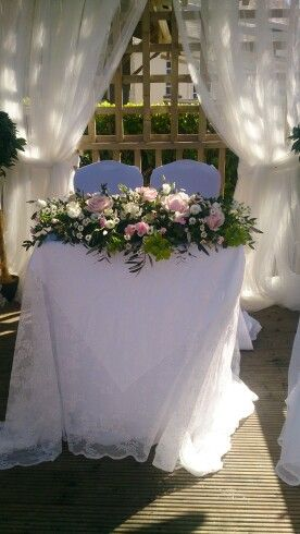 Natural free form long and low flower arrangement for ceremony table
