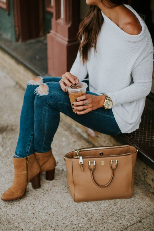 I like these boots and the sweater looks fun. I have jeans similar to this.
