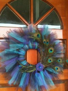 Make a Peacock Inspired wreath out of tulle. Tie tulle strips on a foam wreath base as you would normally tie tulle on elastic or ribbon.