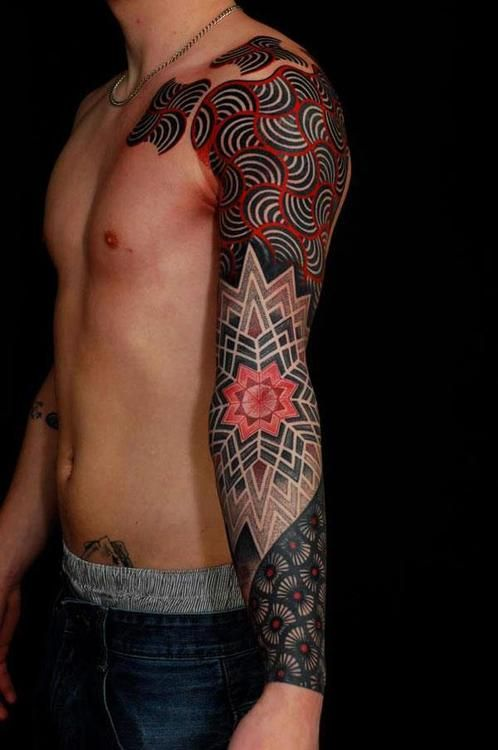 Done by Gerhard Weisbeck. Great unique tattoo artist. (men's tattoo sleeve-colorful almost textiled pattern black and red with striped swirls, flowers, few colors, puzzle piece influence on top)-BirdY