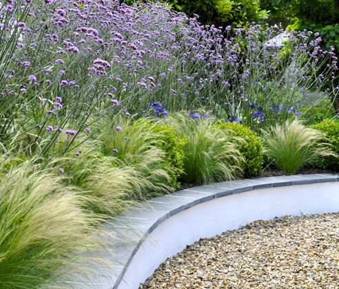Sweeps and Curves | Sue Townsend Garden Design | Idea to cover raised flower border with slate tiles if it keeps cracking