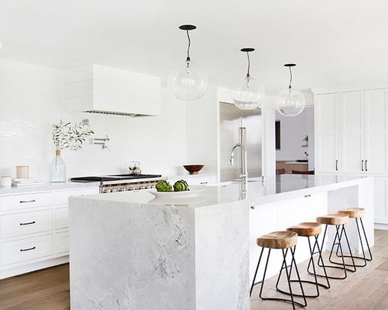 Marble is the ideal material for a modern and fancy kitchen where you will love to gather all your friends around. Whether you pick a table made all out of marble or you choose a marble facade, here a