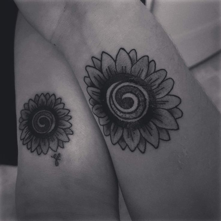 First tattoo for me!  Mother Daughter - sunflowers with gratitude symbol as center.  Daughter designed and drew. <3.