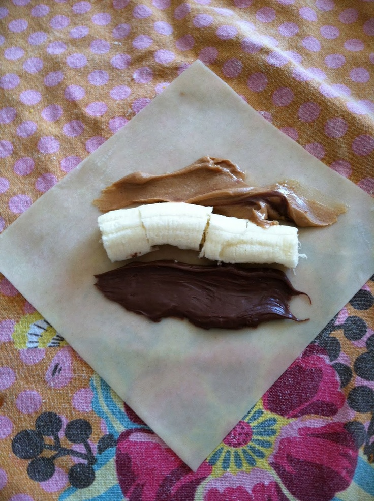Baked Banana and Nutella Egg Rolls  Preheat the oven to 425 degrees.  Once all of the egg rolls are on the baking sheet, spray all of them with cooking spray (this will help them brown a bit).  Bake for 8 minutes. Turn each egg roll. Bake another 5 minutes.