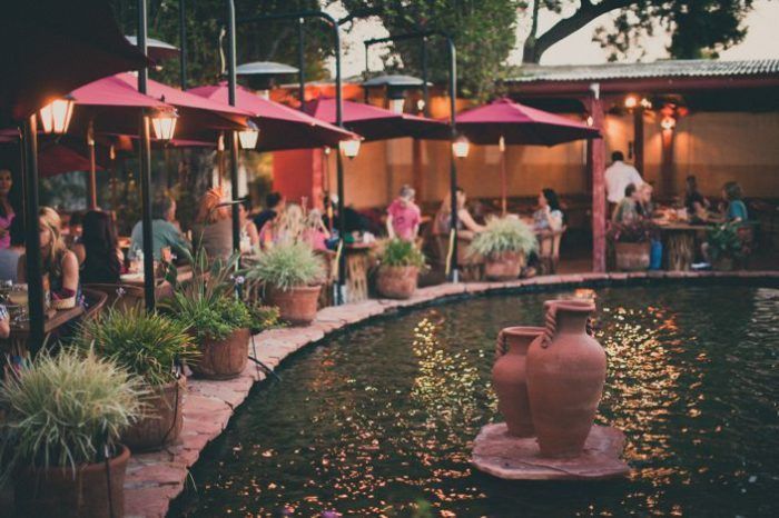 Escondido:  It's a secluded oasis surrounded by a pond, a soothing waterfall, towering trees, and warm lights that cast a romantic glow on the patio.