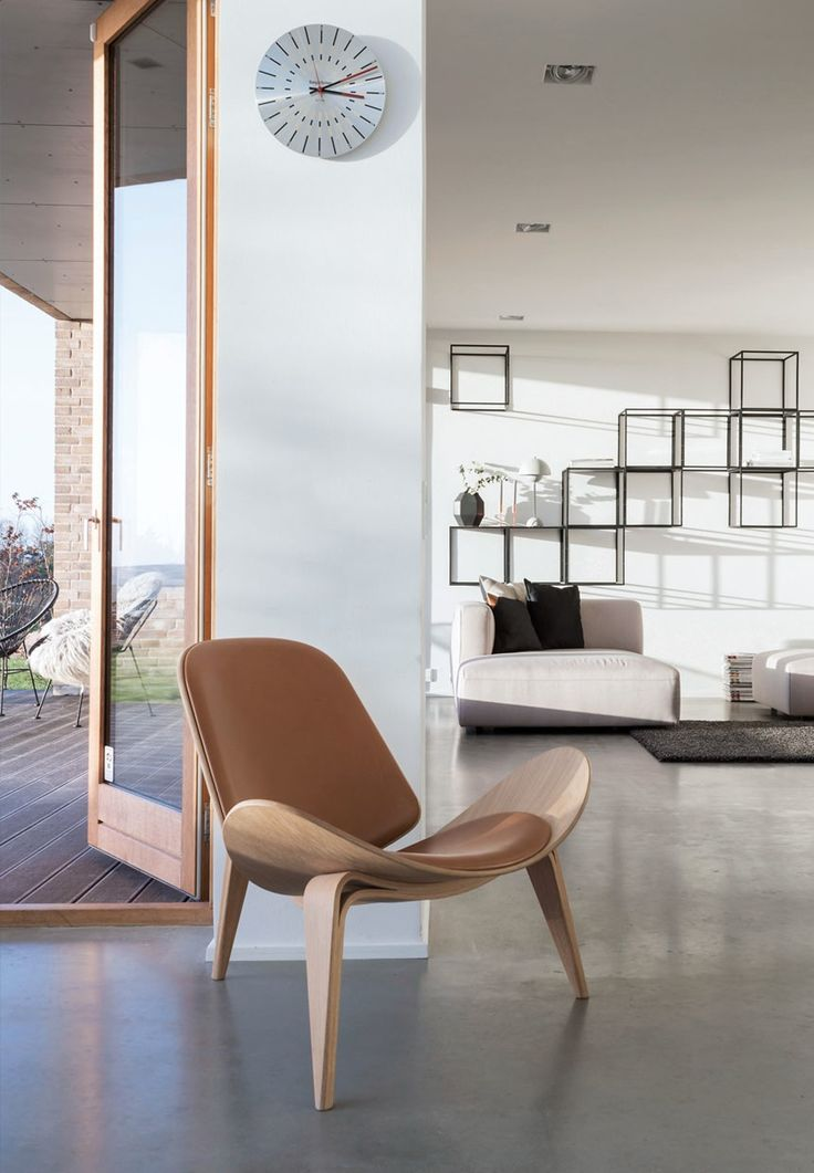 Hans J. Wegners Shell Chair in brown leather.