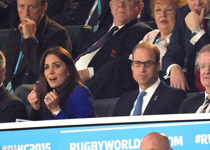 A clear view: The Duke (pictured, right, with his wife) was spotted putting on a pair of black-framed glasses before the game kicked off at 8pm. His wife, meanwhile, was animated as the match got underway, clenching her hands into balls and frowning as she took in the view