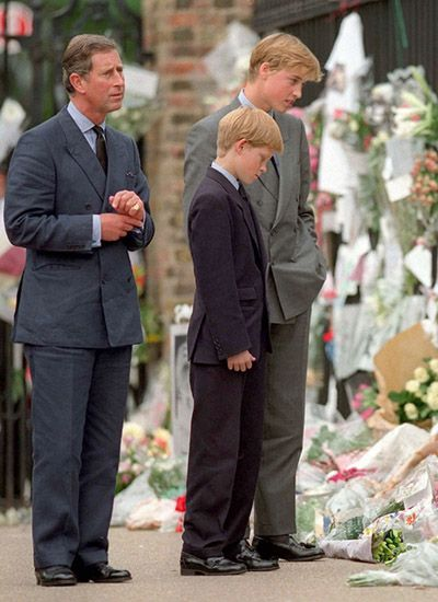 Princes Charles, William and Harry, viewing the massive display of floral tributes in front of the Palace from the people in honor of their ex-wife and adored Mummy.
