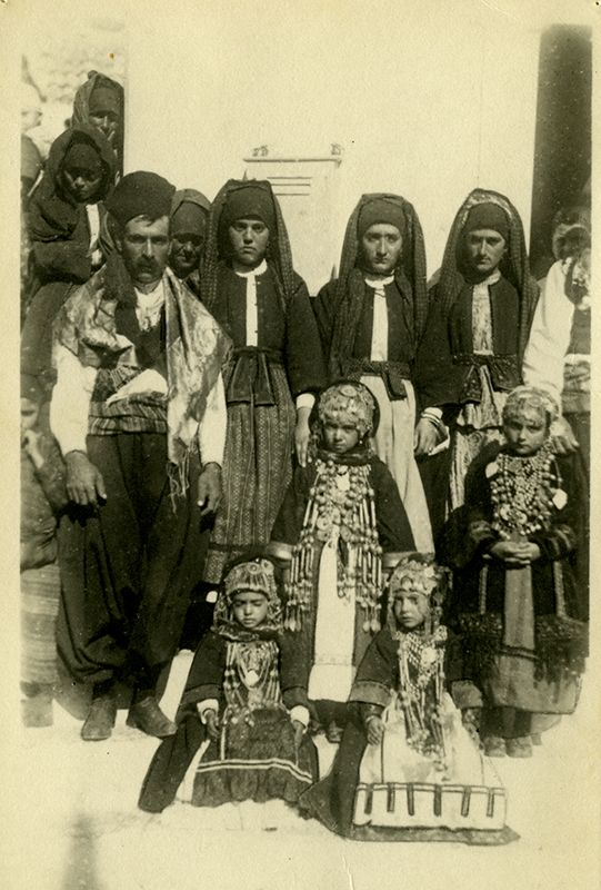 Photo of women, men and kanakares (firstborn girls) of Karpathos, Dodecanese, wearing local costumes. Early 20th century ©Peloponnesian Folklore Foundation, Nafplion, Greece