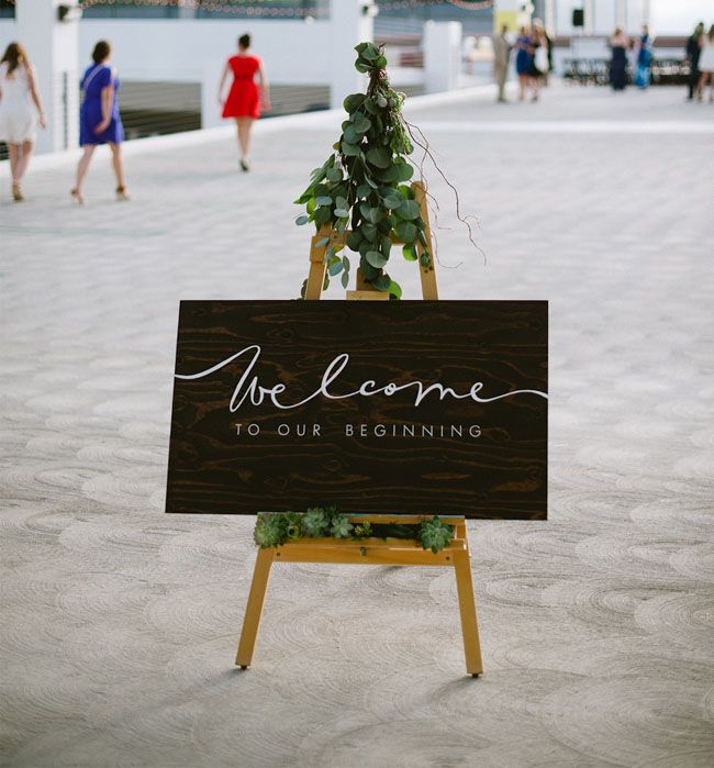 LOVE this - again: Modern, graphic, organic all rolled into one. The calligraphy is done by the woman who will be doing my envelopes - would love to have something like this near the entrance and maybe next to the escort card table/concept