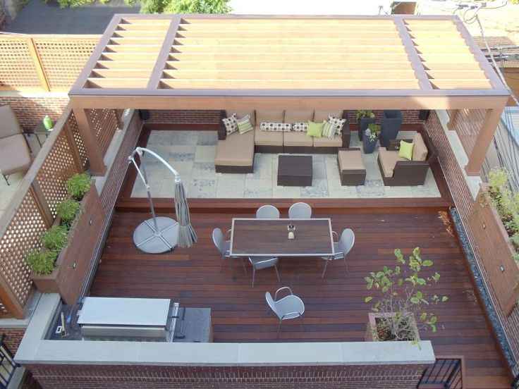 This contemporary garage roof deck features a sleak cedar pergola with aluminum flashing and built in low voltage lighting.  Ipe decking is ...