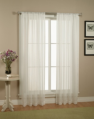 White sheer curtains for the living room. One panel on each window on either side of the fireplace.