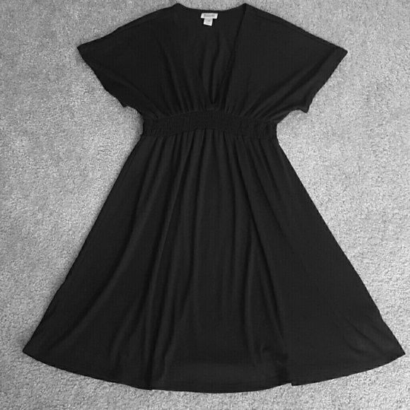 Simple Black Dress All black dress size M. Worn once - super soft an flowy  black dress. Would be super cute with some brown riding boots an a scarf or could even be dressed up with heels a statement necklace or even throw over a swim suit heading to the beach! Would have to wear a cami/tank underneath as the v is deep. 68% polyester  28% rayon  4% spandex which is all the elastic around waist/under bust area. Dresses