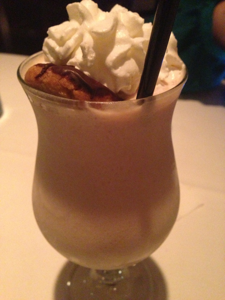 The Shake Down cocktail: Maker's Mark, Godiva white, peanut butter, vanilla ice cream, whipped cream and garnished with a chocolate covered peanut butter cookie. At Tavern at the Park in Chicago.