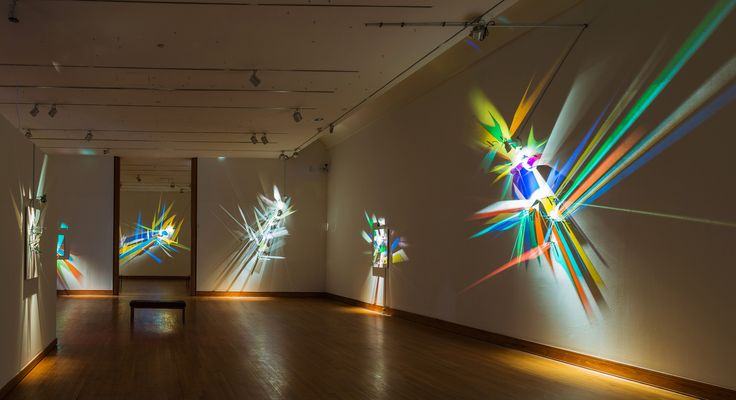 """Stephen Knapp: Lightpainting.  On view through August 27th, 2016.  Pensacola Museum of Art,  Pensacola, Florida www.pensacolamuseum.org  Stephen Knapp dispenses with traditional media to create sculptural canvases composed entirely of light and glass. Heralded as the first new art medium of the 21st century the artist has been developing his """"lightpaintings"""" since the late 1990s.  Credit:   Installation view. Image provided by artist, Stephen Knapp."""