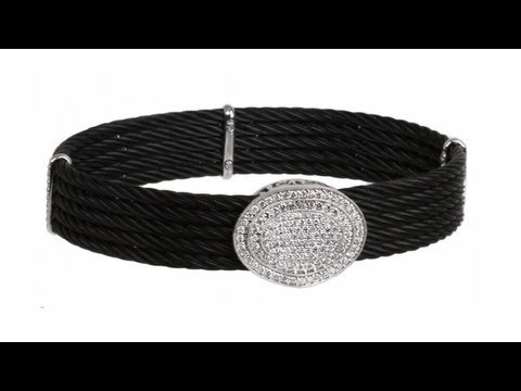 To buy now click on the link: http://shrsl.com/?~3fr2  The #Charriol #Celtic #Noir Black #Cable and #18k #White #Gold #Bangle features #celtic #noir black #cables with #18k #white #gold accents and a 1.09ct #diamond encrusted oval disk centerpiece. With a magnetic closure, this bangle fits a small to medium wrist and is 1/2 inches wide. #International #Luxury #Jewelry #Brand, Charriol, was founded in Geneva, Switzerland in 1983 by Philippe Charriol