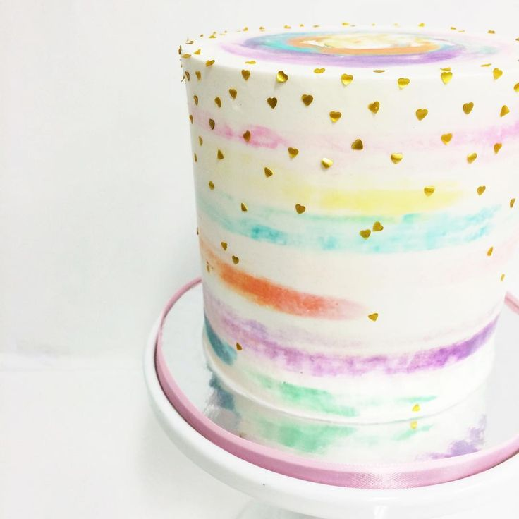 A cutesy watercolor cake sprinkled with teeny tiny gold hearts 💖 Design by @lady_pritchard #sweetandsaucyshop #buttercreamcake #watercolorcake #cakestagram #instacake