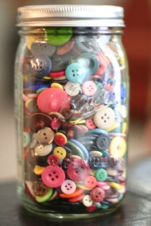 When I was a little girl, my granny had a mason jar full of buttons that she would let us string.  One of my best memories.  I don't know what happened to those buttons but they were loved.  I've started  my own mason jar of buttons for my dollies.  Hopefully they will enjoy them as much as I did.