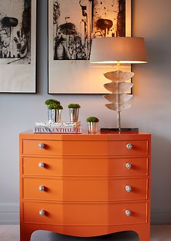 interior design ideas - vibrant orange dresser: