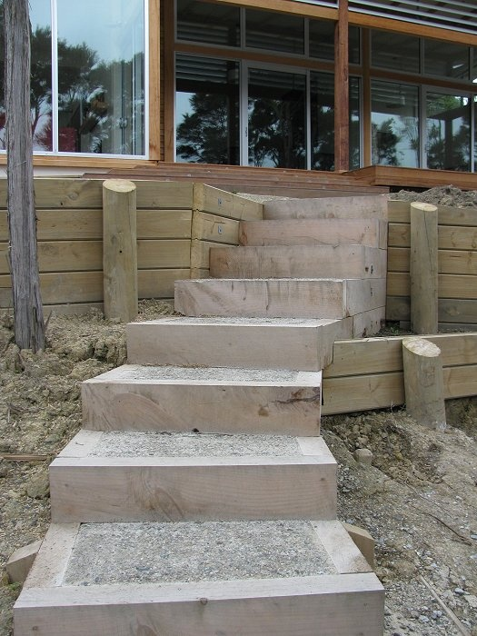 Macrocarpa steps with concrete infill. Exposed aggregate surface.
