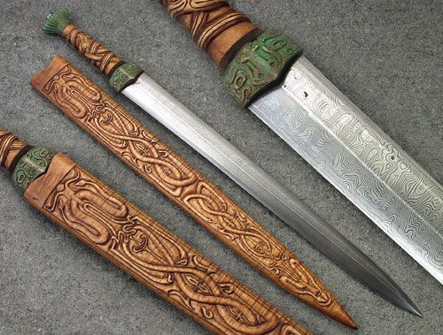 """Qin Period Chinese Sword  The blade is 20"""" L6/O1, scabbard and grip darkenned curly maple, fittings patinated bronze.  It's based on ancient qin period chinese swords.  www.powning.com"""
