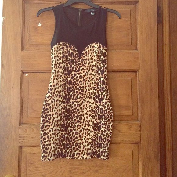 Cheetah print bodycon dress Bodycon cheetah print dress with mesh back! Super cute for a night out! Worn only a handful of times to functions. Forever 21 Dresses