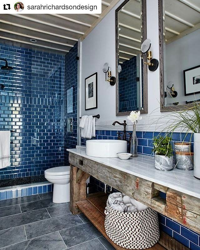 #Repost @sarahrichardsondesign ・・・  True blues, smokey stone, a pebble shower floor, barn beam vanity and a board and batten ceiling all add up to a country style guest bath. Check it out on my new tv series #sarahoffthegrid ep 2 on hgtv.ca  tap for sources and see all the pics on my website! #srdesignlife #sotg #hgtv #sarahoffthegrid #bathroomreno #guestbathroom #showerglass  Copyright : Adanac Glass