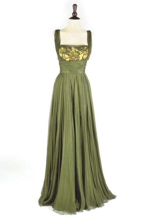 Helen Rose green silk chiffon, 1950's. Similar in design to the High Society gown.  What is awesome here is the gathered swath that twists around the body and appears to form the shoulder straps. Unlike the HS dress, the embroidery is kept to one distinct panel and made to appear deeper or further back in the design.