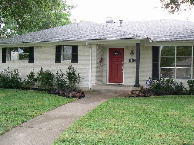 Red door white painted brick black shutters exterior for Ranch house front door