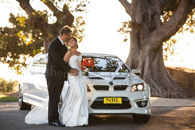 Bride & Groom with the HSV limousine