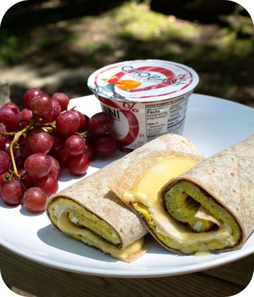 Easy lunch ideas for kids and adults: three-egg omelet with turkey breast and smoked gouda rolled in a whole-wheat tortilla; grapes; and a blood orange Greek yogurt. http://www.LunchBoxBlues.com