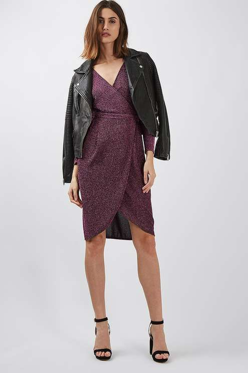 The most flattering style of the season, the wrap dress is seriously trending. This glitter tie wrap dress in a gorgeous shimmery purple is proof - from its knee-length cut, practical long sleeves and v-neck detail. We love to team with strappy heels for a polished finish. #Topshop