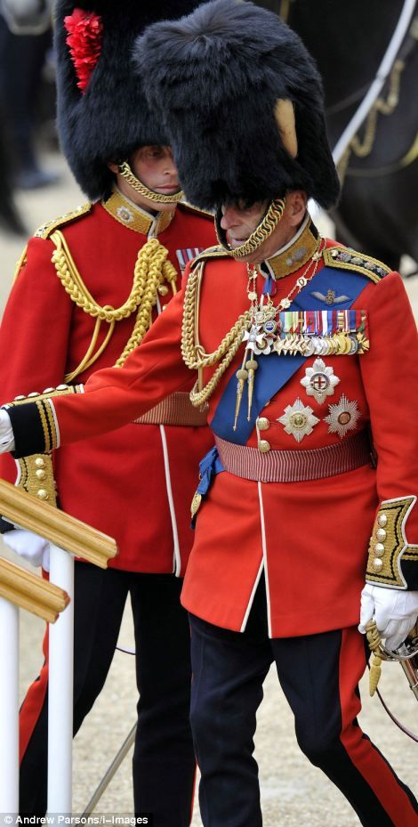 Pomp and ceremony: With a wave to the crowds, Prince Philip joins the Royal Family for the magnificent Trooping the Colour parade