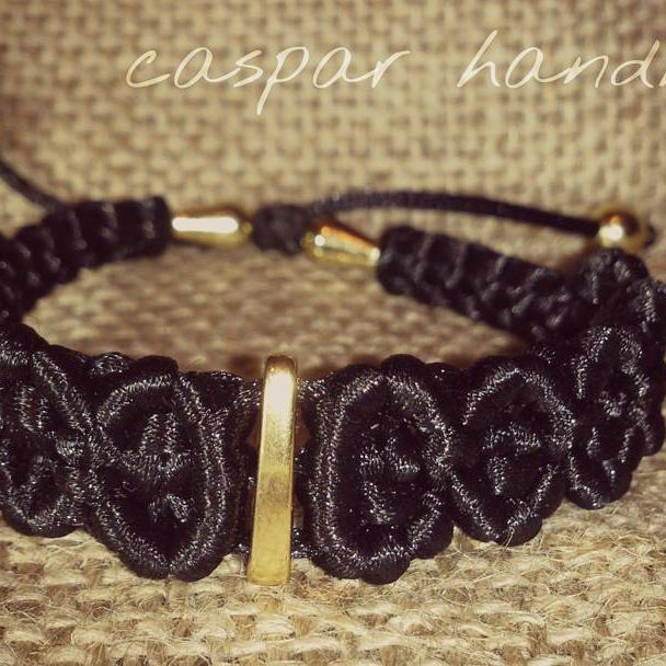 black macrame bracelet with golden details