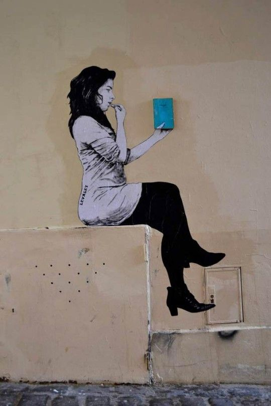 A French street artist Levalet creates collages on city walls across France. Some of his works show people reading. And what they are reading are actually real books #streetart