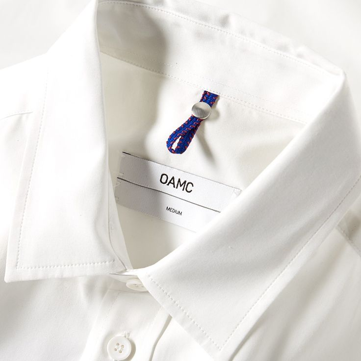 Taken from OAMC's Spring/Summer 2016 collection, the Tradition Shirt takes a classic cotton shirt and updates it with bold brush strokes. Crafted in Italy and styled with a single pocket to the chest, the shirt is finished with a yolk and box pleat to the back for a comfortable fit.  100% Cotton Printed Brush Stroke Pattern Chest Pocket Stud Branding To Back Back Yolk & Box Pleat Curved Hem Made In Italy