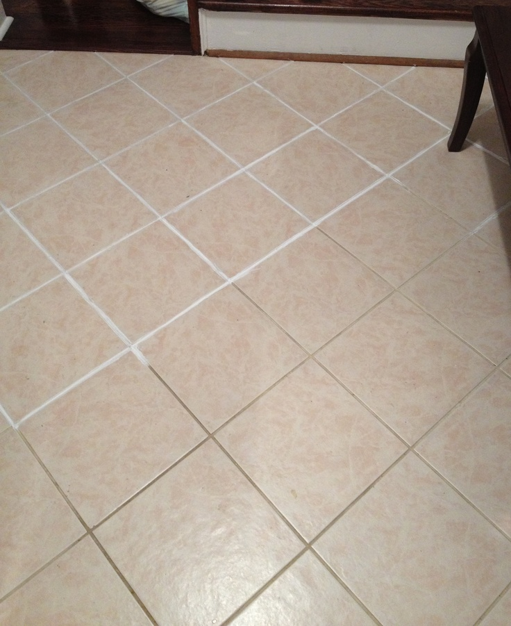 Use White Waterproof Shower Caulking Over Existing Grout.