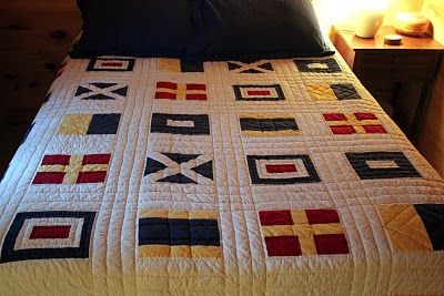 Nautical quilt, love the white quilted section around the flags, it would make a great base for a bed bumper
