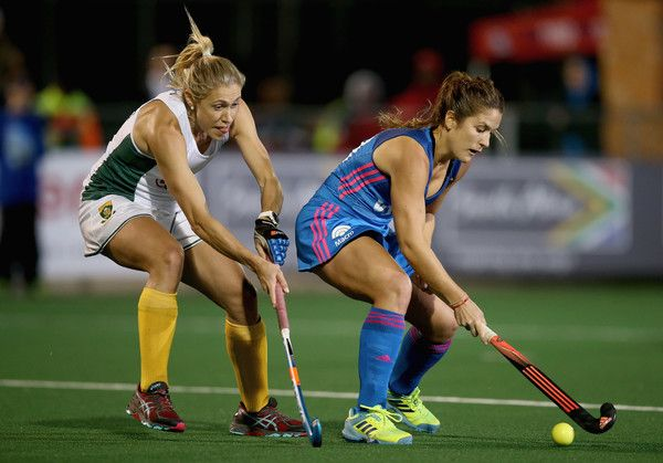 Julia Gomes of Argentina and Shelley Jones of South Africa battle for possession during day 3 of the FIH Hockey World League Semi Finals Pool B match between South Africa and Argentina at Wits University on July 12, 2017 in Johannesburg, South Africa.