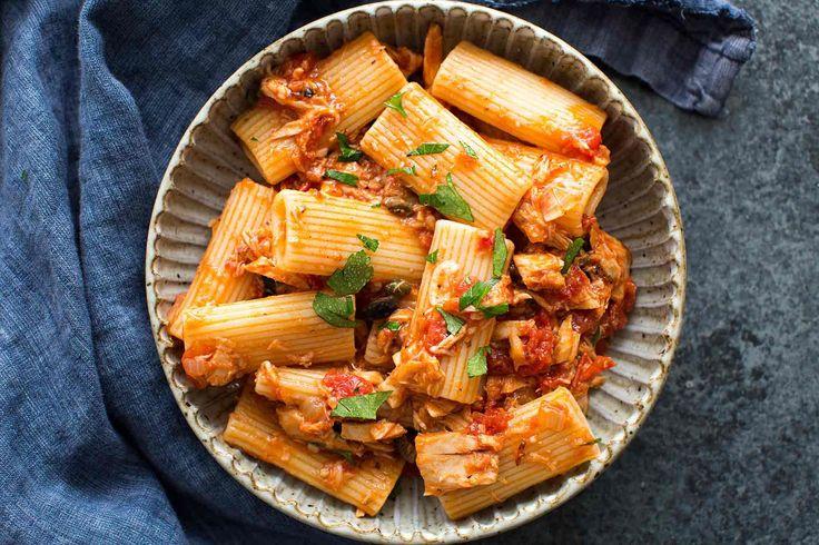 Easy to make! Pasta with sauce of tuna, tomato, garlic, shallots, olives, parsley.