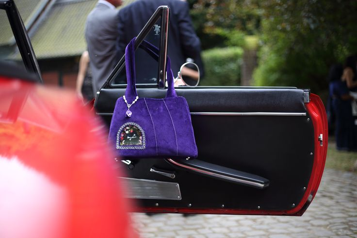 velvet handbag with a miniature altar http://vitaocculta.com/handbags/handbags-violet-and-silver.htm