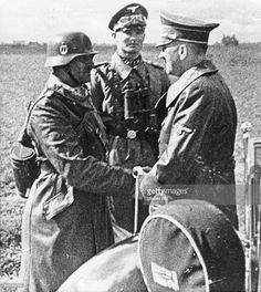 . /nChancellor of Germany, 1933-45. Hitler (far right) with Joseph 'Sepp' Dietrich (far left), commander of the SS-Leibstandarte, near Warsaw during the German invasion of Poland at the start of World War II, 25 September 1939.