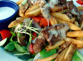 The Pittsburgh Salad..Lettuce, tomatoes, french fries, steak, cheese and dressing