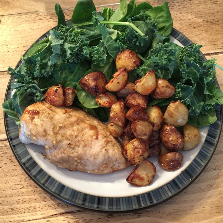 Sweet chicken and potatoes served with uncooked spinach and kale following The Body Coach 90 Day SSS plan.