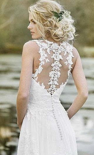 Featured Dress: Lillian West; Wedding dress idea.