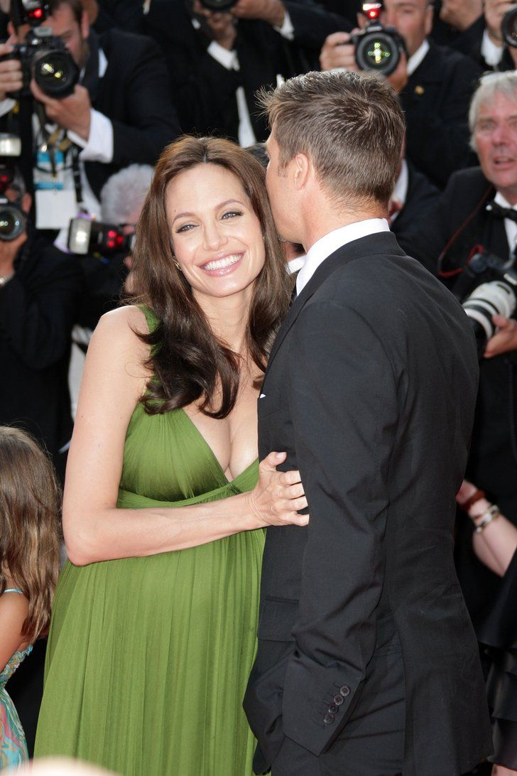 Brad gave his girl a kiss at the Cannes Film Festival in May 2008. | The Way They Were — 31 Times Brad Pitt and Angelina Jolie Showered Each Other With Love | POPSUGAR Celebrity Photo 24