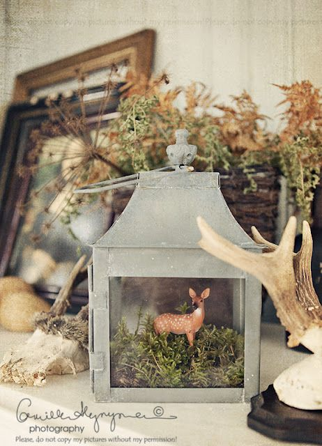 lantern with moss and deer...