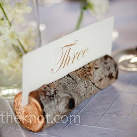 Really cute idea for the table numbers :)