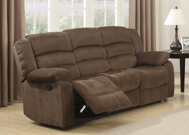 Bill Brown Contemporary Living Room Reclining Sofa. Give your home a new look with this transitional sofa that was built for the family and entertaining. This piece is a part of a collection that has been designed to provide a comfortable seating atmosphere by featuring dual manual reclining mechanisms and a soft padded foot rest. This extremely comfortable sofa will go well in any room in your home. Constructed with select hardwoods and reinforced by a heavy duty steel rail systemCorner…